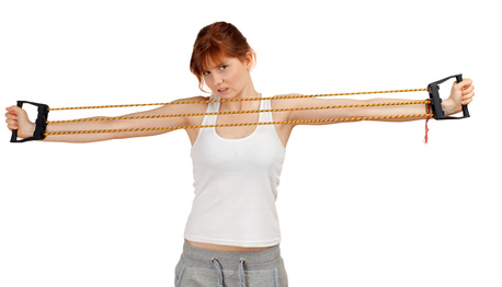 junge Frau mit einem Expander